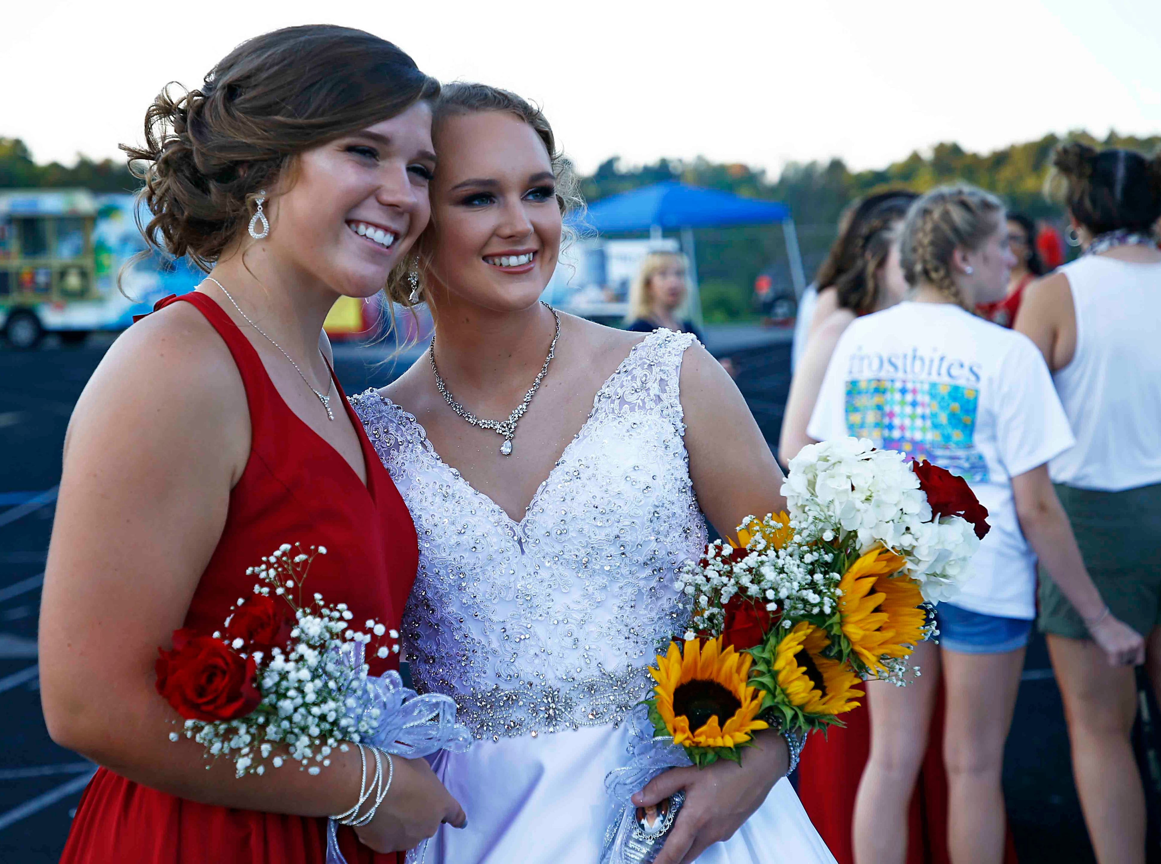 Creek Wood Homecoming Queen Analee Coursey, right, has her photo taken with Emma Street before the game against Montgomery Central Friday, Sept. 14, 2018, in Charlotte, Tenn.