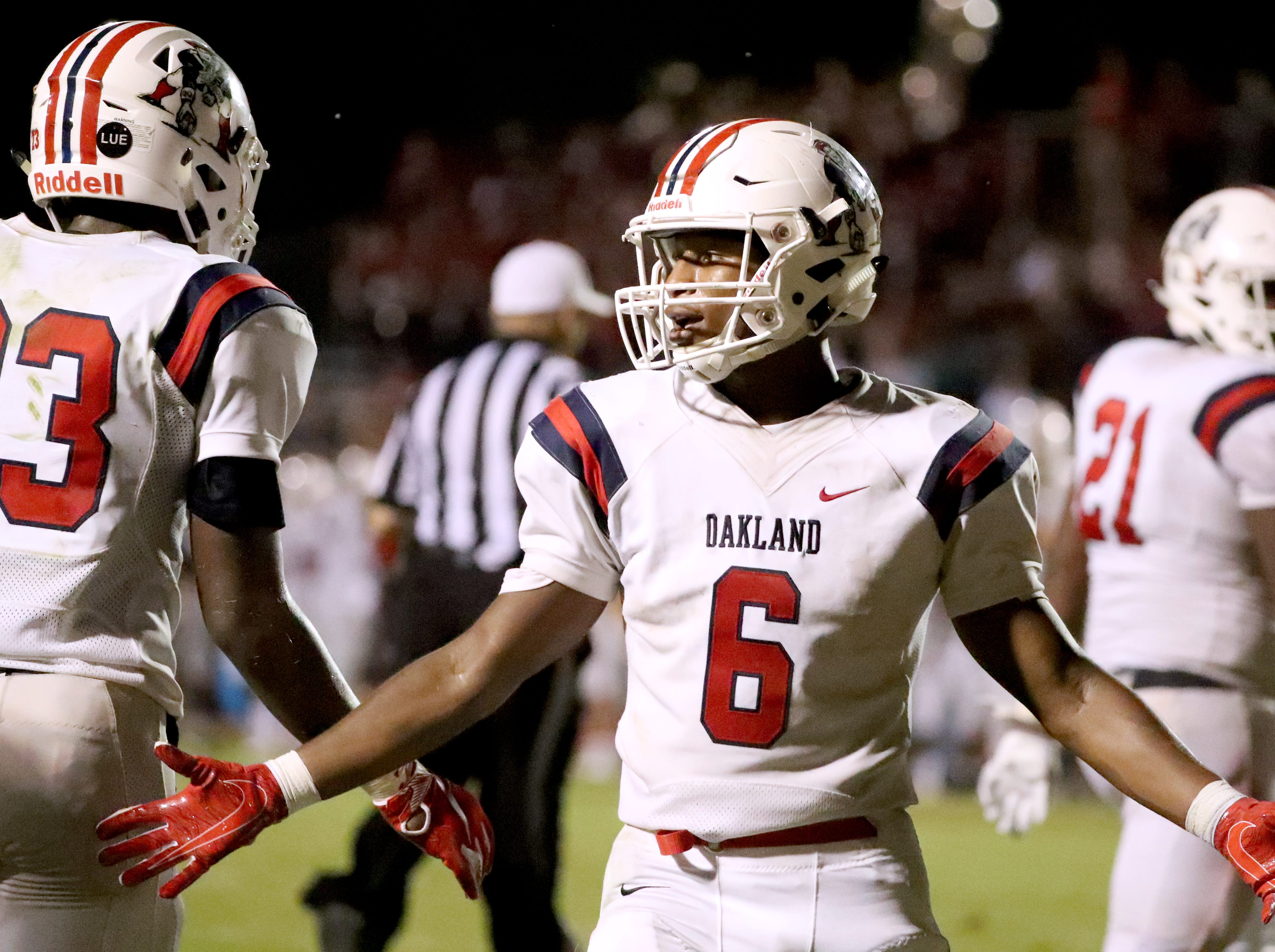 Oakland's Justin Jefferson (6) celebrates his touchdown with his team at Riverdale during the Battle of the Boro on Friday, Sept. 14, 2018.