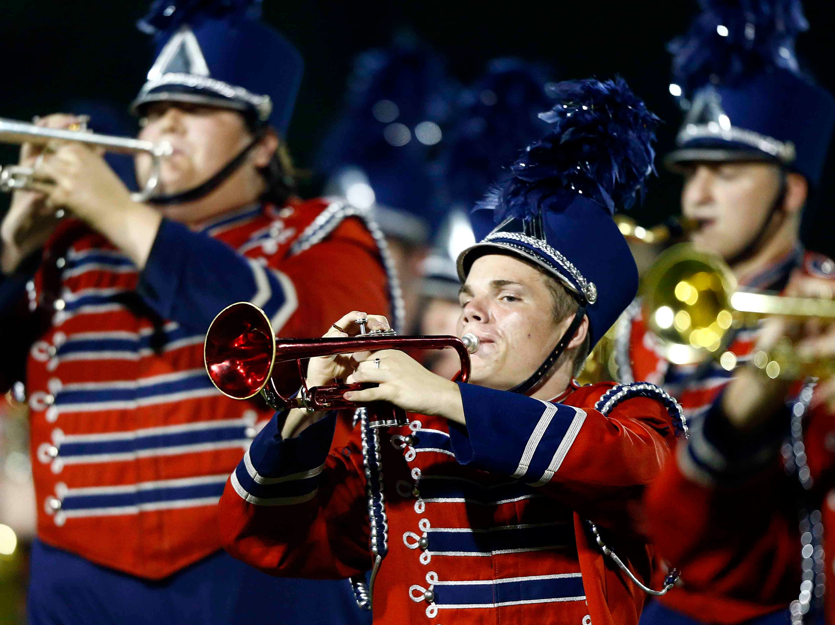 Members of the Creek Wood band perform  the band  during halftime of their game against Montgomery Central Friday, Sept. 14, 2018, in Charlotte, Tenn.