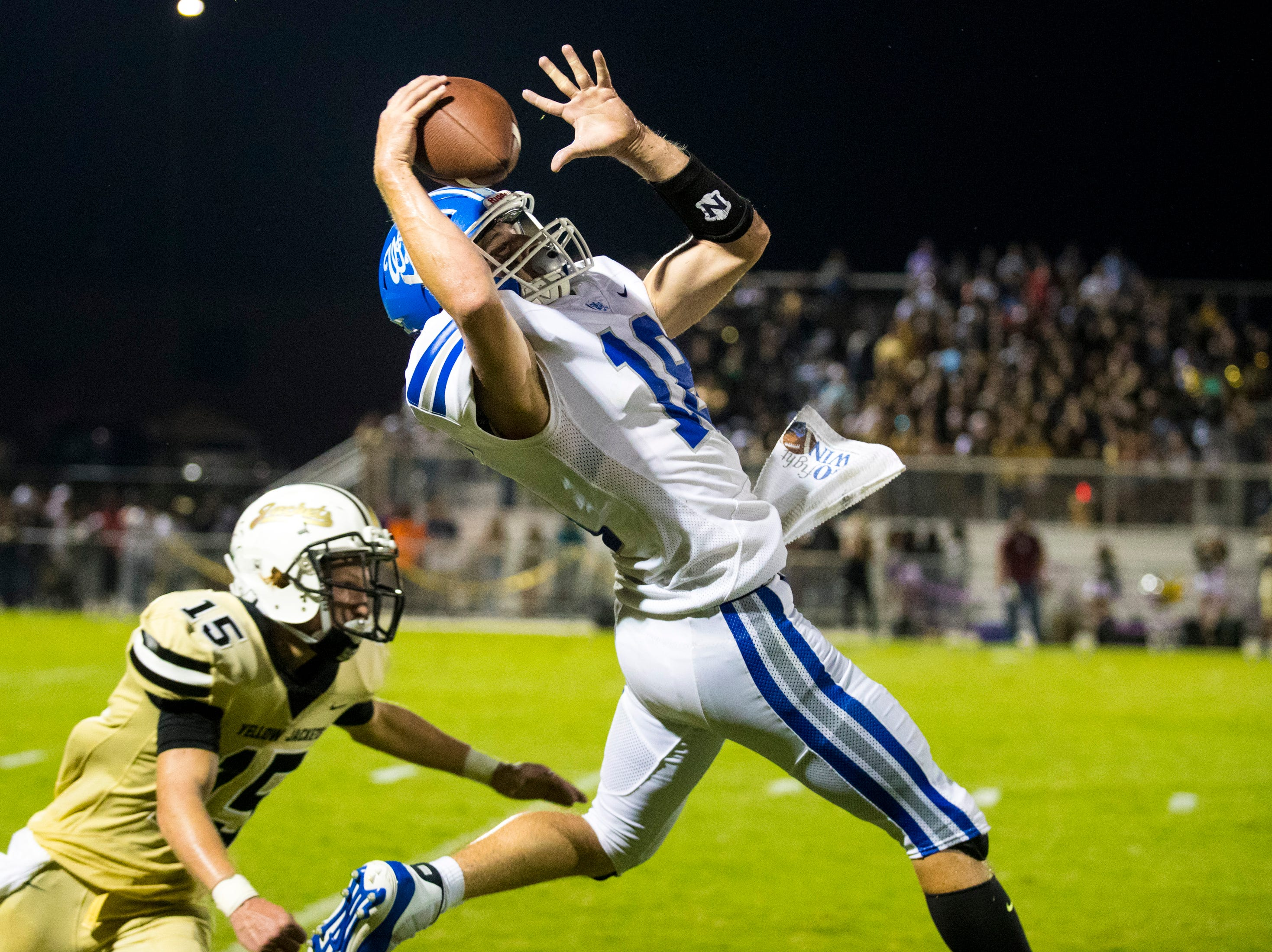 White House's Cameron Casanova (18) catches a long pass one handed during Springfield's game against White House at Springfield High School in Springfield on Friday, Sept. 14, 2018.
