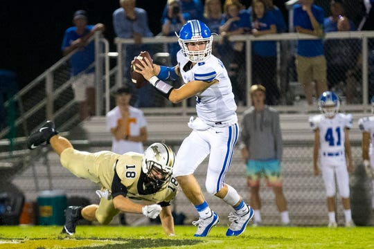 White House's Andrew Nixon (6) dodges a tackle from Springfield's Colton Wachter (18) during Springfield's game against White House at Springfield High School in Springfield on Friday, Sept. 14, 2018.