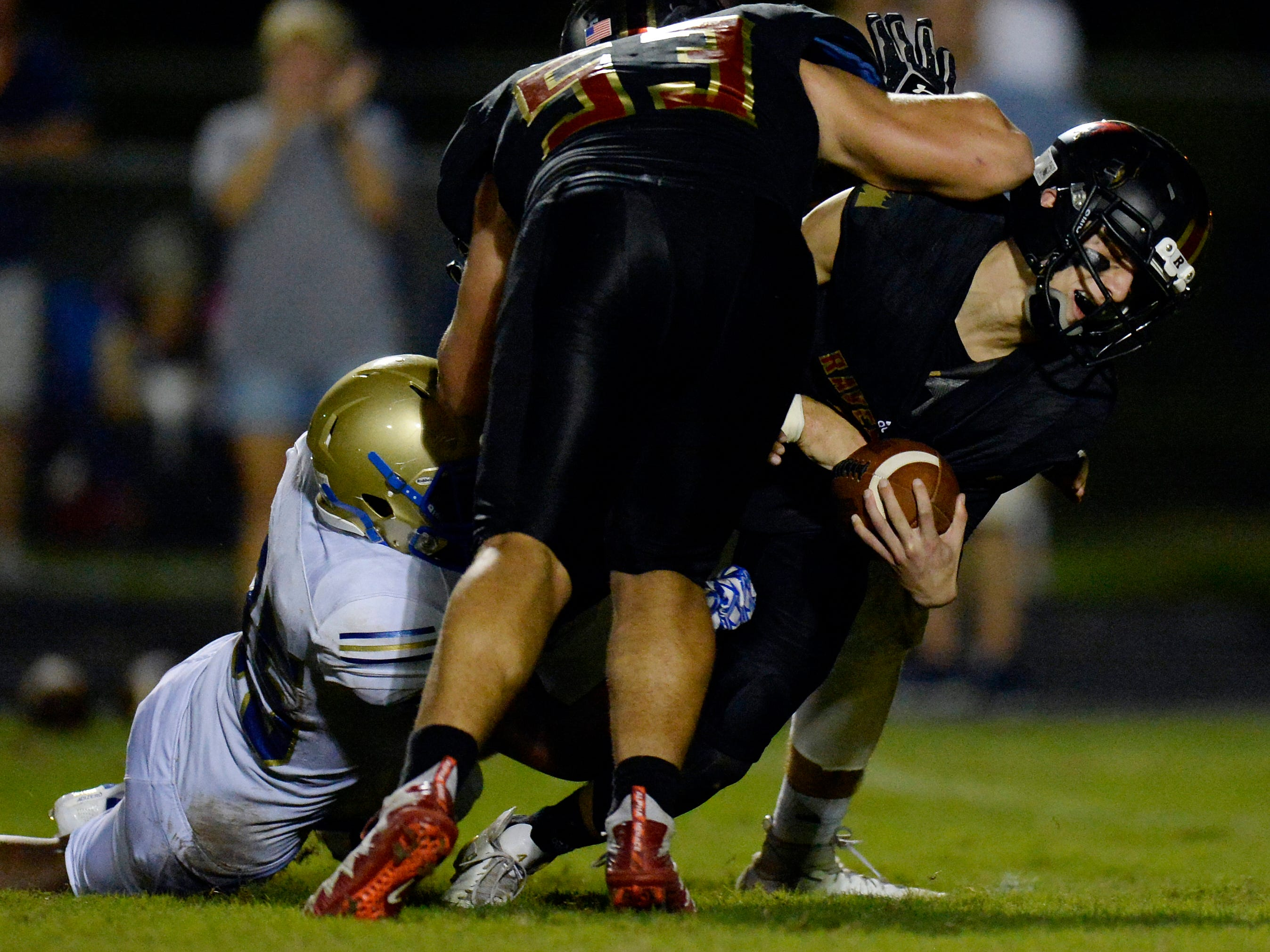 Brentwood linebacker Kaleb Williford, left, sacks Ravenwood quarterback Brian Garcia, right, during the second half of a high school football game Friday, September 14, 2018, in Brentwood, Tenn. Brentwood won 31-28.