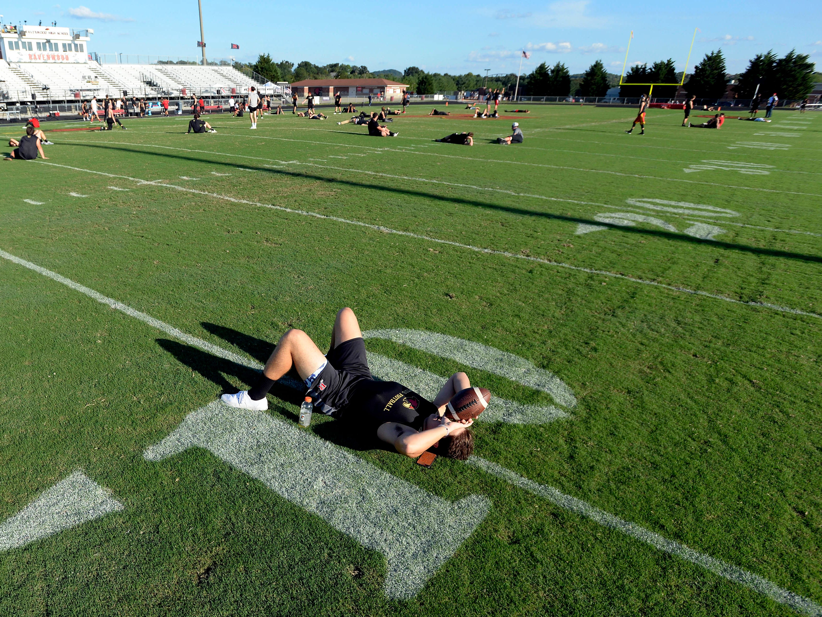 Ravenwood tackle Gabriel Sleenhof rests on the field before the team's high school football game against Brentwood Friday, September 14, 2018, in Brentwood, Tenn.