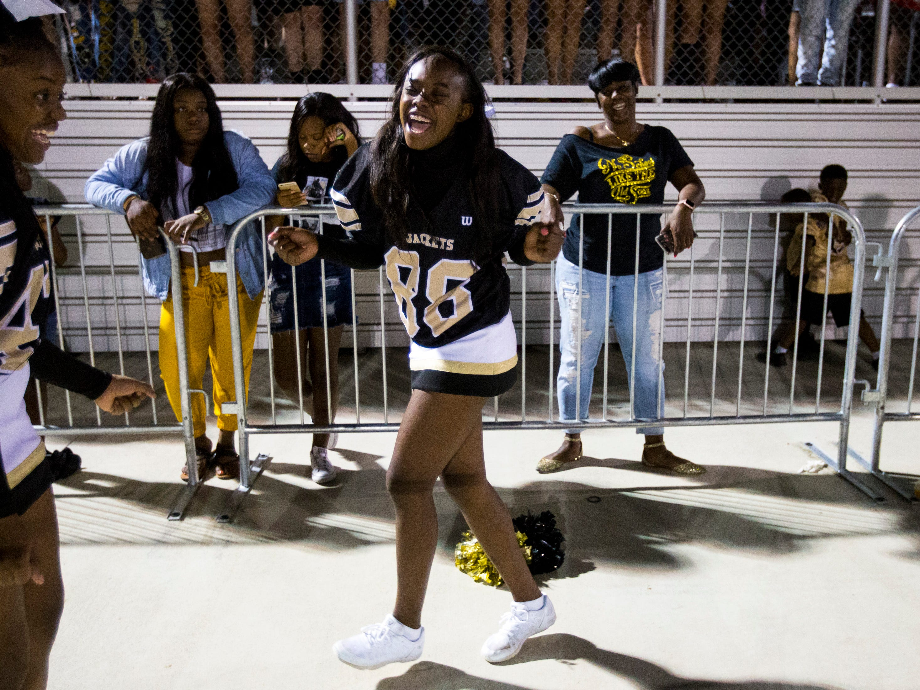 Springfield cheerleader Detreona Hurt dances after a big play during Springfield's game against White House at Springfield High School in Springfield on Friday, Sept. 14, 2018.