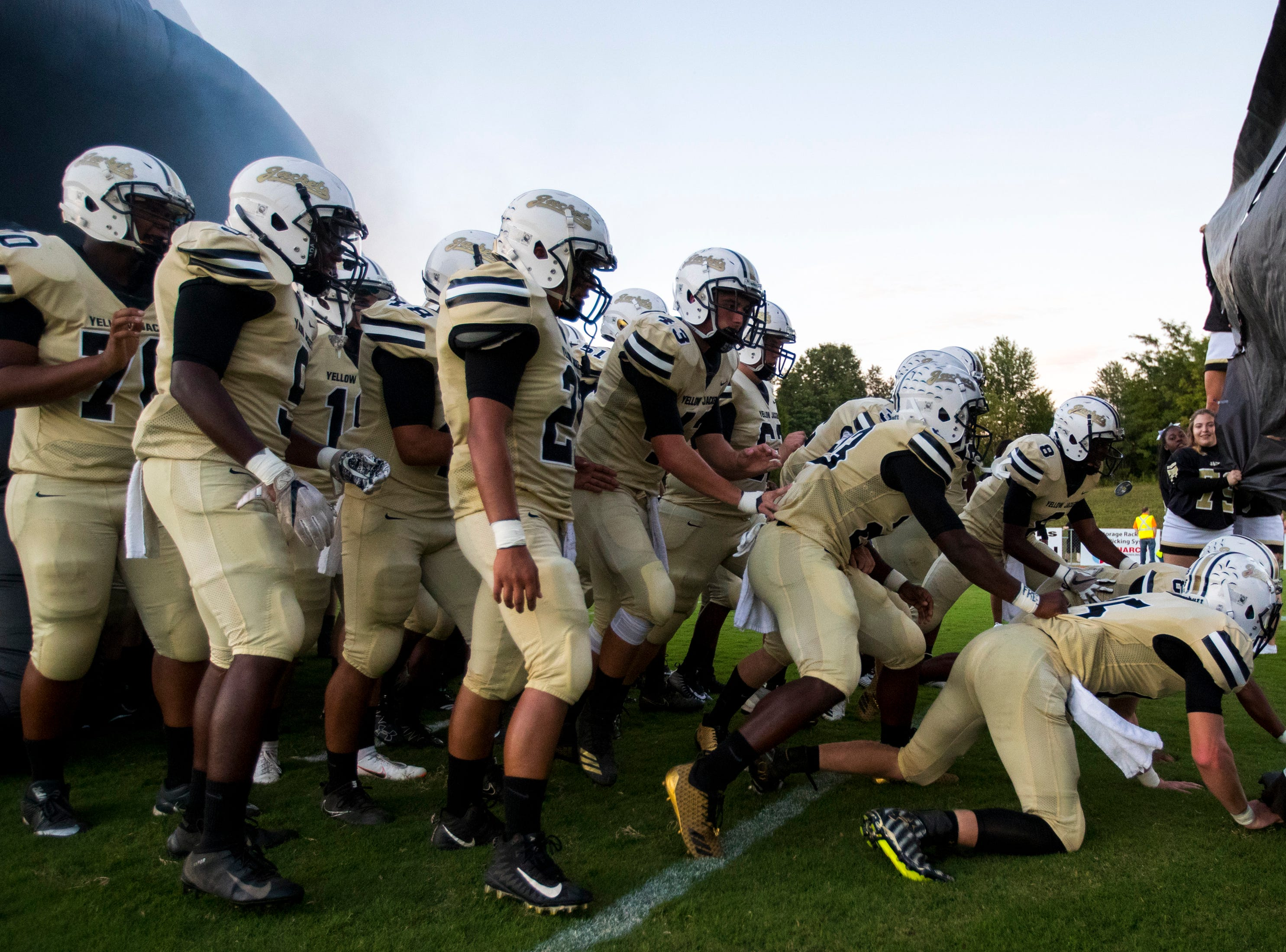 Springfield's players get ready to take the field before Springfield's game against White House at Springfield High School in Springfield on Friday, Sept. 14, 2018.