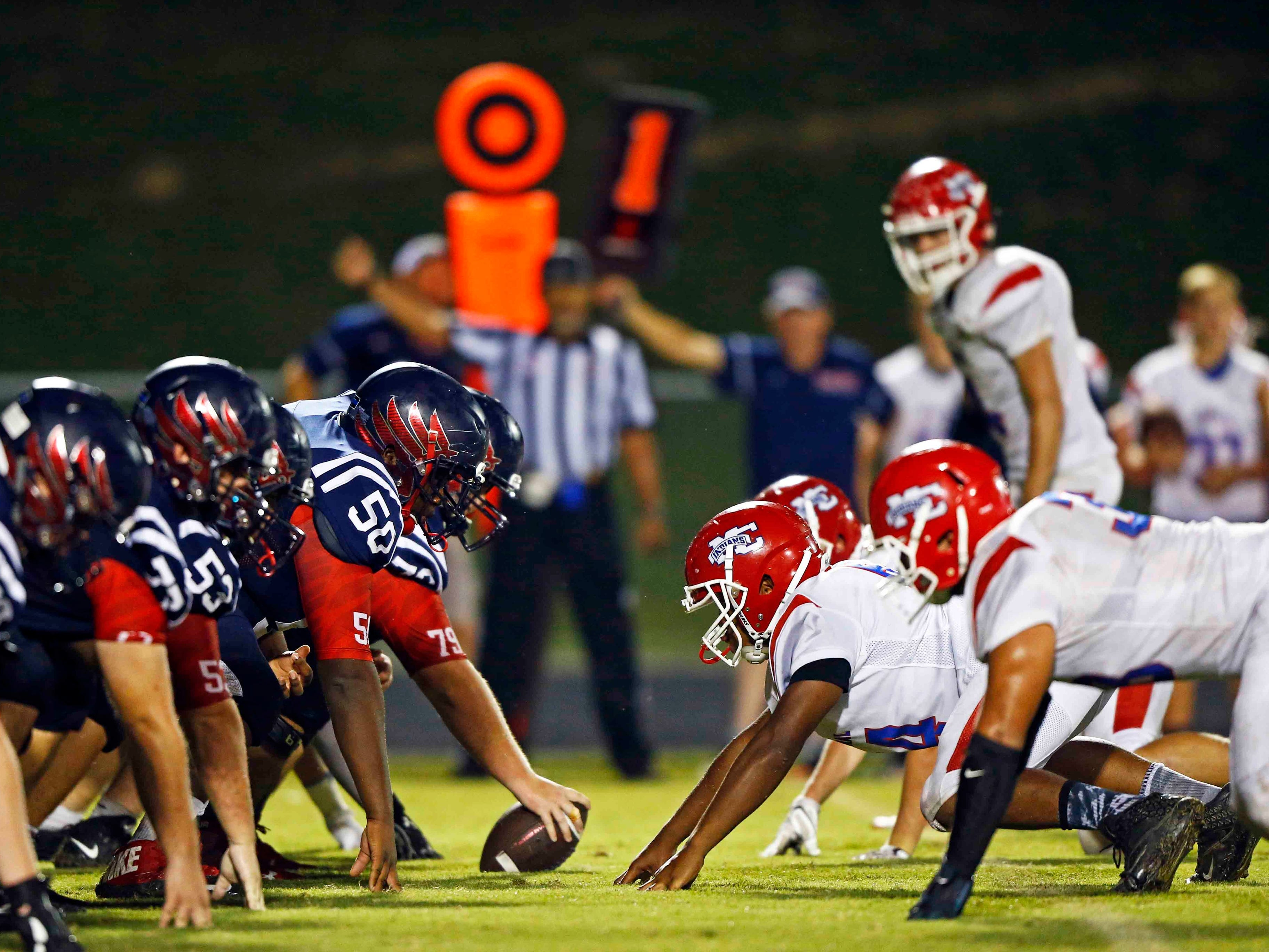 Creek Wood and Montgomery Central line up against each other during their game Friday, Sept. 14, 2018, in Charlotte, Tenn.