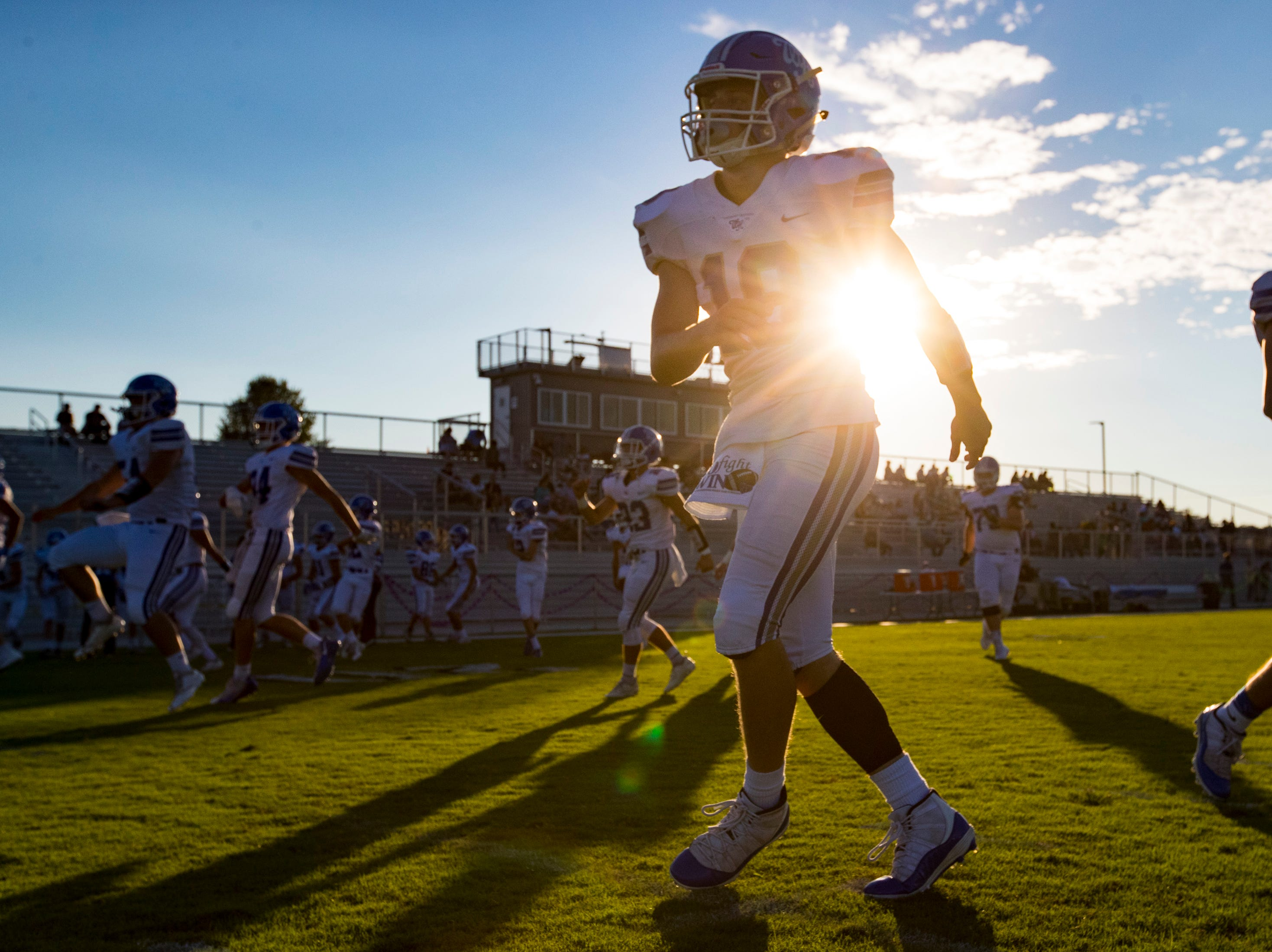 White House's Cameron Casanova (18) warms up with his teammates before Springfield's game against White House at Springfield High School in Springfield on Friday, Sept. 14, 2018.