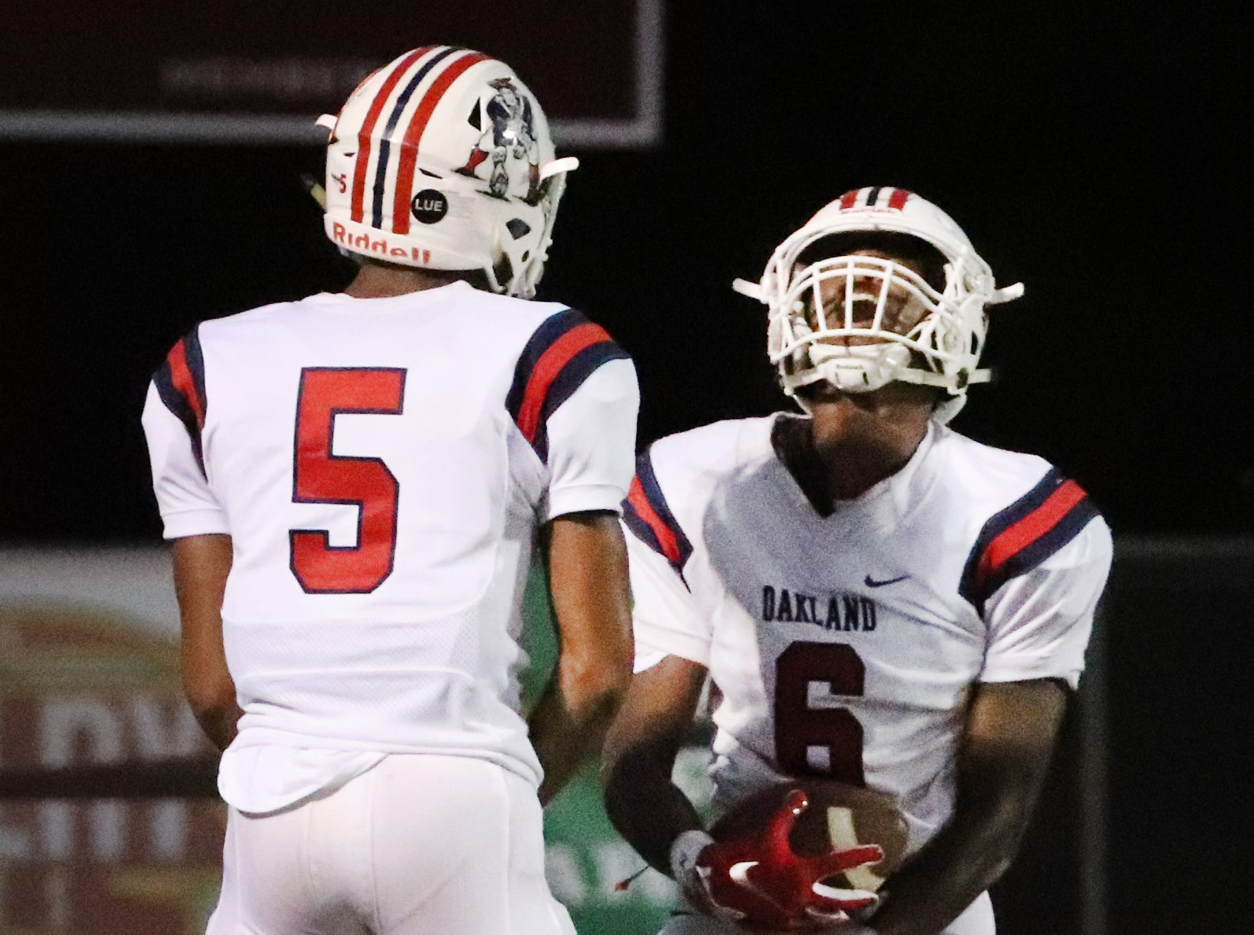 Oakland's Justin Jefferson (6) celebrates his touchdown against Riverdale with Woodi Washington (5) at Riverdale during the Battle of the Boro on Friday, Sept. 14, 2018.