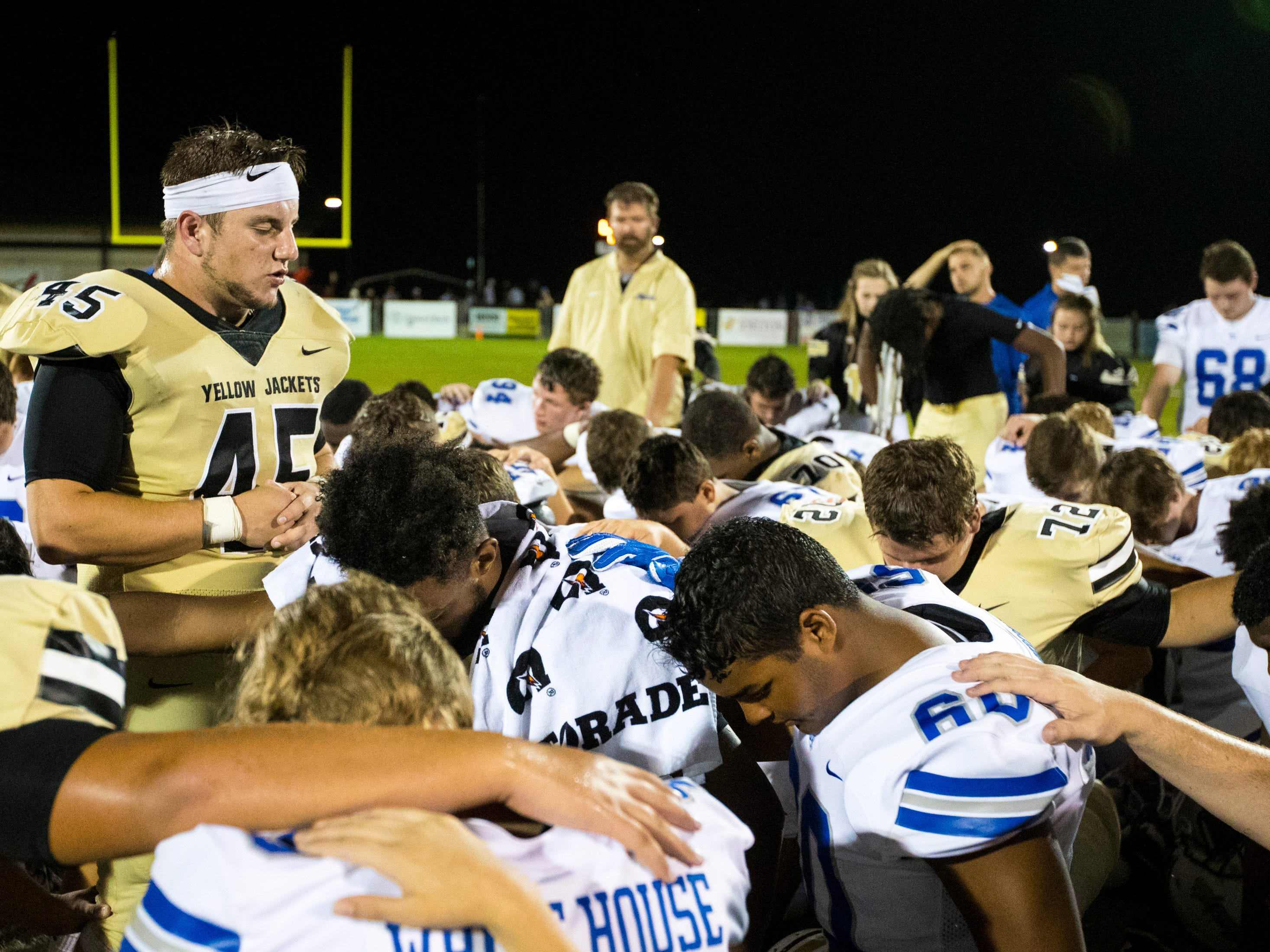 Springfield's Benjamin Galluzzi (45) leads a prayer after Springfield's game against White House at Springfield High School in Springfield on Friday, Sept. 14, 2018.