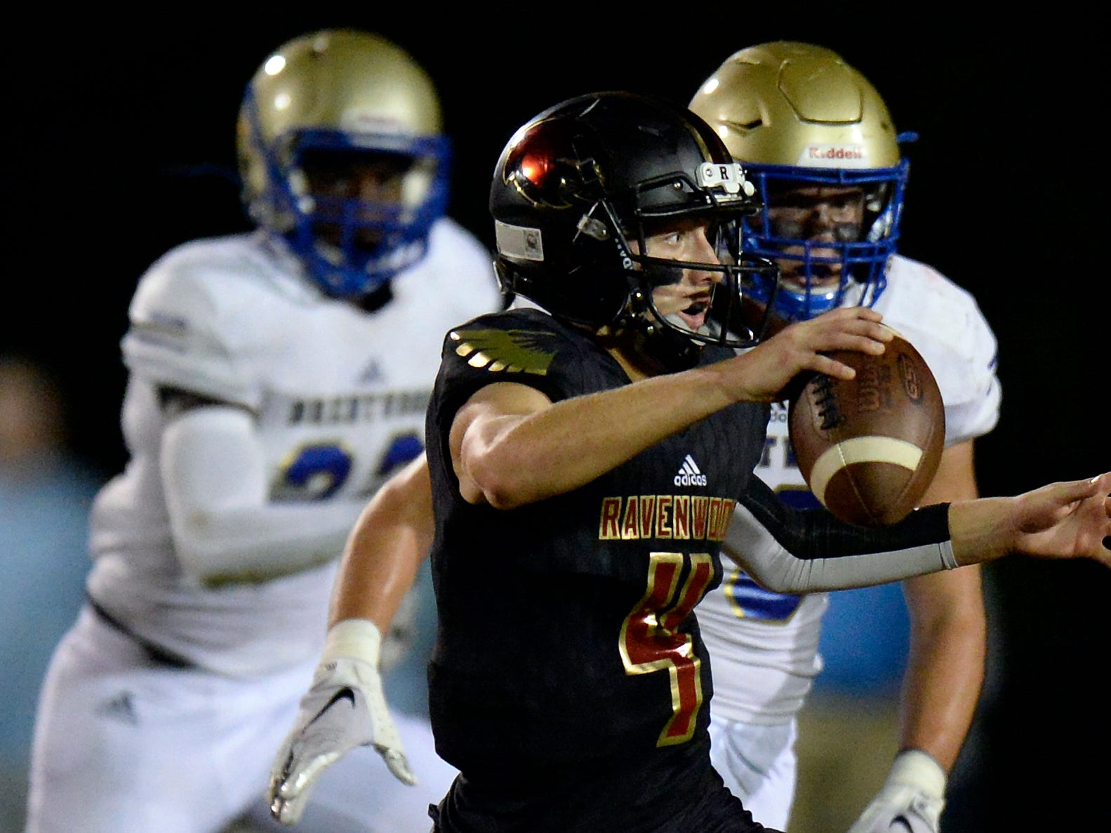 Ravenwood quarterback Brian Garcia (4) runs the ball against Brentwood during the first half of an high school football game Friday, September 14, 2018, in Brentwood, Tenn.