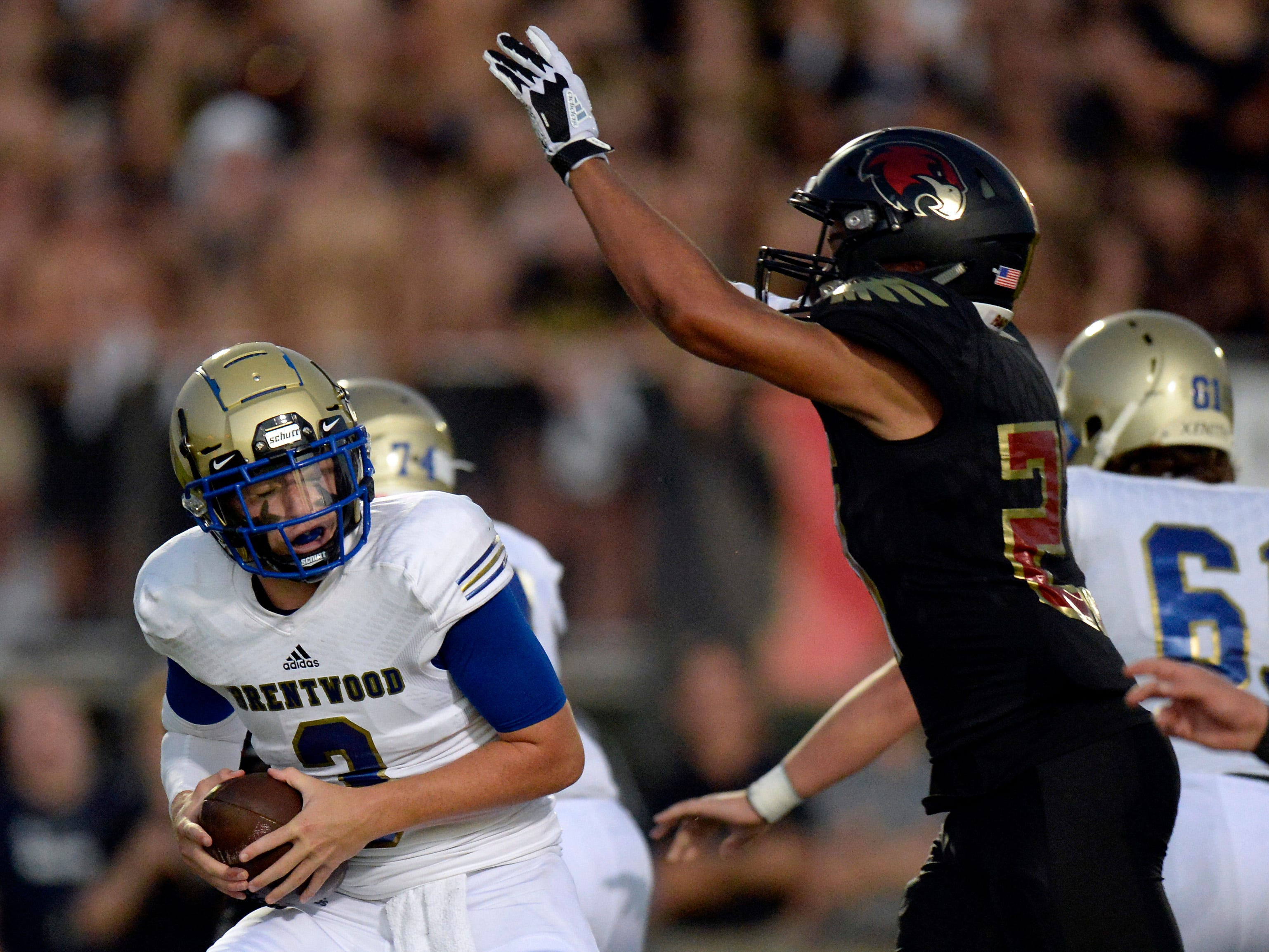 Brentwood quarterback Cade Granzow (3) tries to pass as Ravenwood strong safety Myles Dawson (23) rushes in during the first half of an high school football game Friday, September 14, 2018, in Brentwood, Tenn.