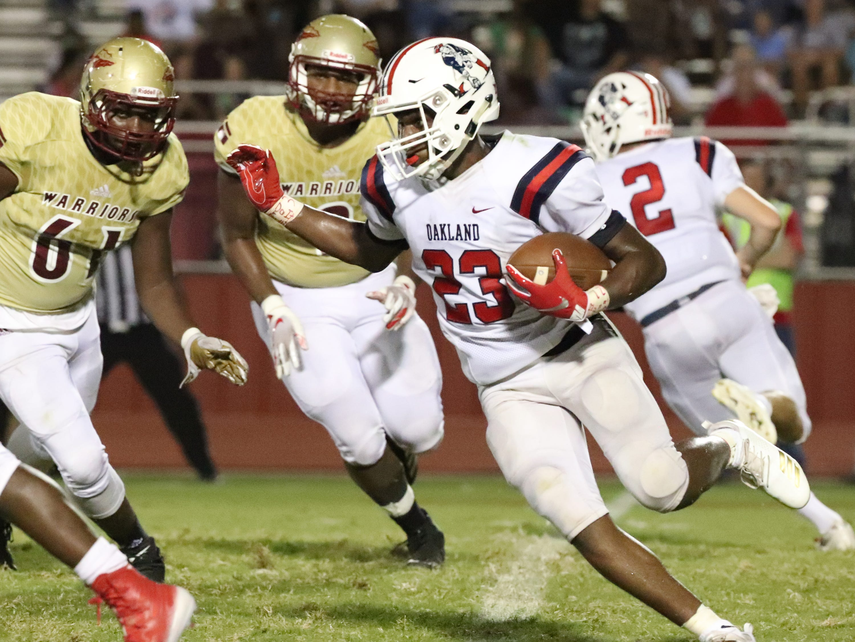 Oakland's BJ Connard (23) runs the ball against Riverdale, at Riverdale, during the Battle of the Boro on Friday, Sept. 14, 2018.