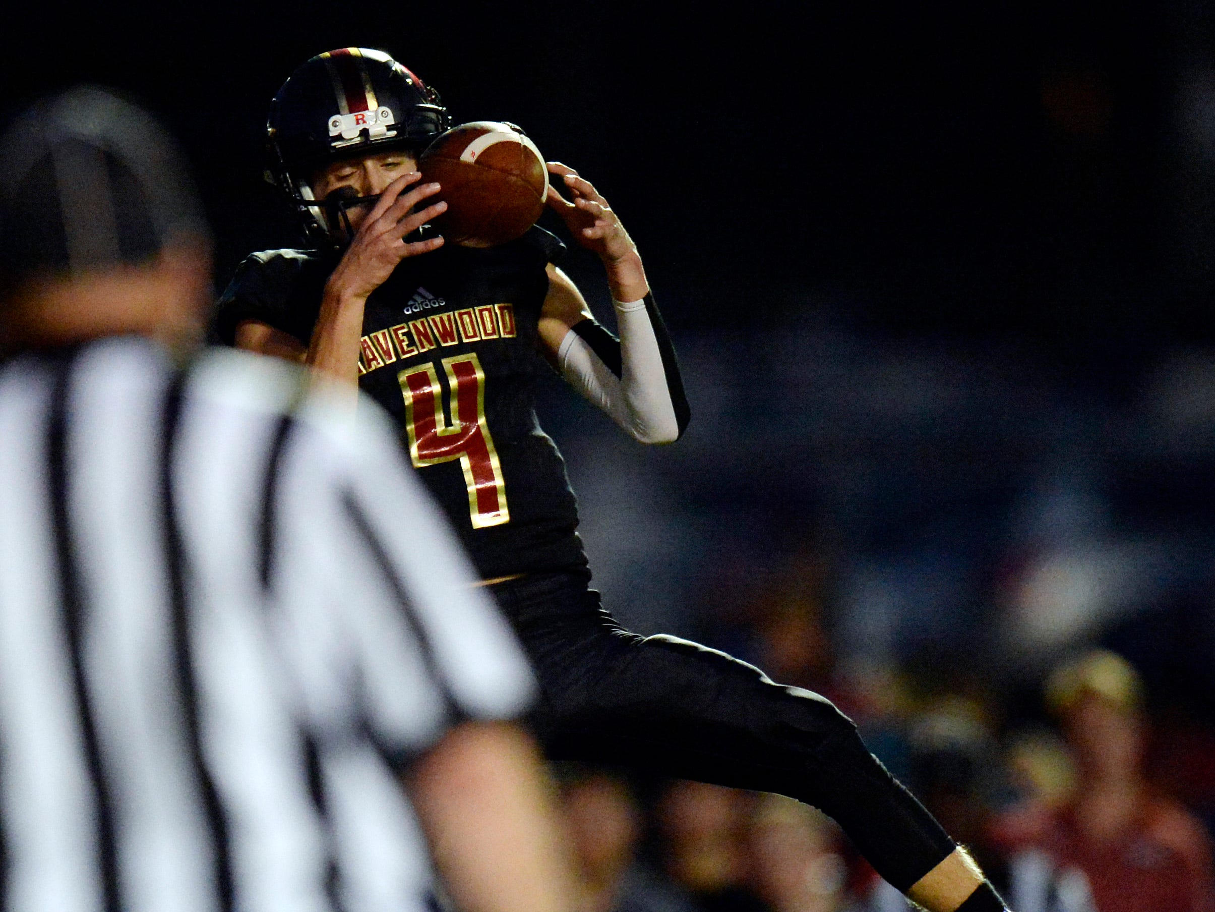 Ravenwood quarterback Brian Garcia (4) catches the ball for a touchdown against Brentwood during the first half of an high school football game Friday, September 14, 2018, in Brentwood, Tenn.