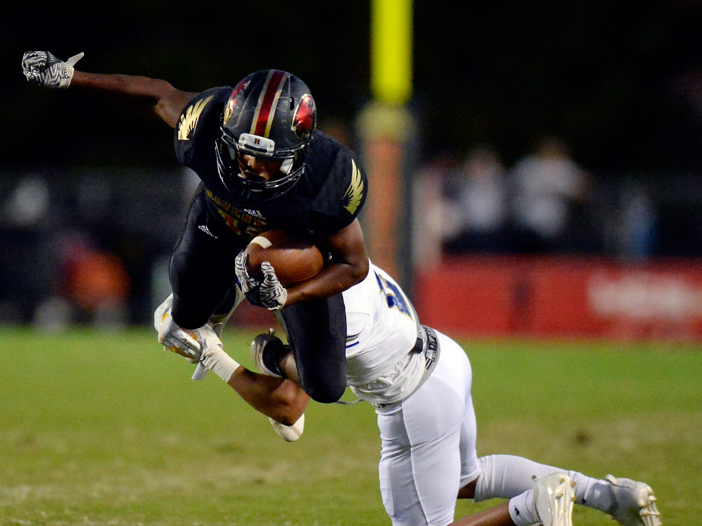Ravenwood running back Tony Rice (10) is brought down by Brentwood cornerback  Davis White (2) during the first half of an high school football game Friday, September 14, 2018, in Brentwood, Tenn.