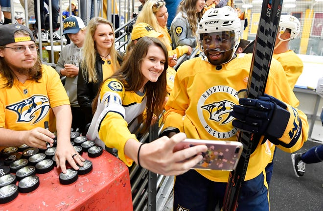 Predators defenseman P.K. Subban poses for a photo with a fan at Centennial Sportsplex Saturday, Sept. 15, 2018, in Nashville, Tenn.
