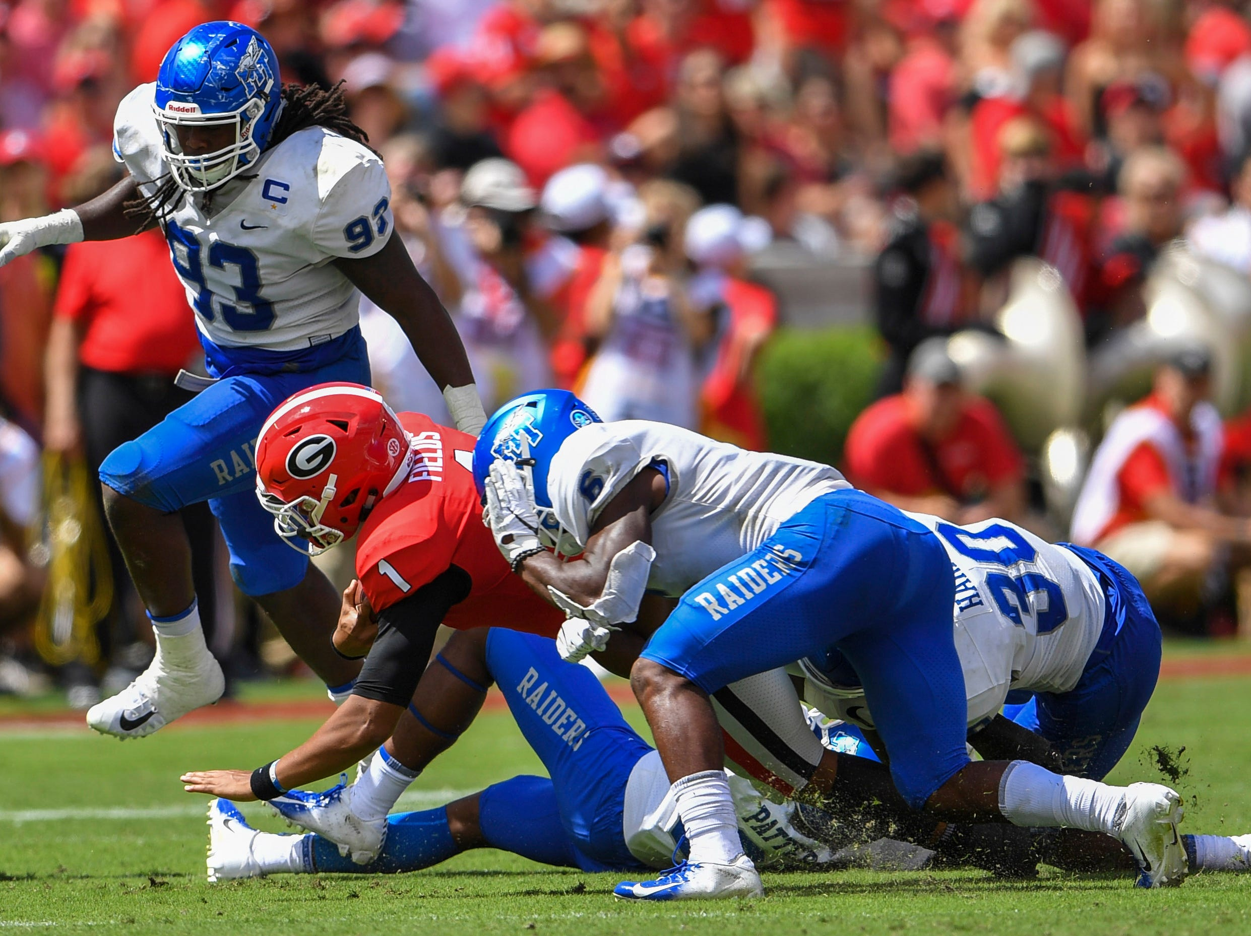 Sep 15, 2018; Athens, GA, USA; Middle Tennessee Blue Raiders linebacker Khalil Brooks (6) hits Georgia Bulldogs quarterback Justin Fields (1) with his helmet resulting in a targeting penalty during the first half at Sanford Stadium. Mandatory Credit: Dale Zanine-USA TODAY Sports