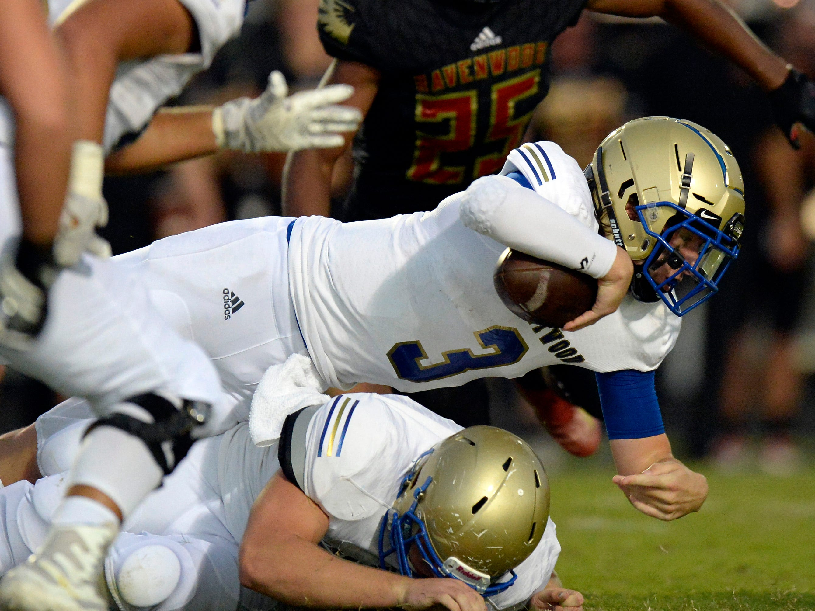 Brentwood quarterback Cade Granzow (3) dives for a first down against Ravenwood during the first half of an high school football game Friday, September 14, 2018, in Brentwood, Tenn.