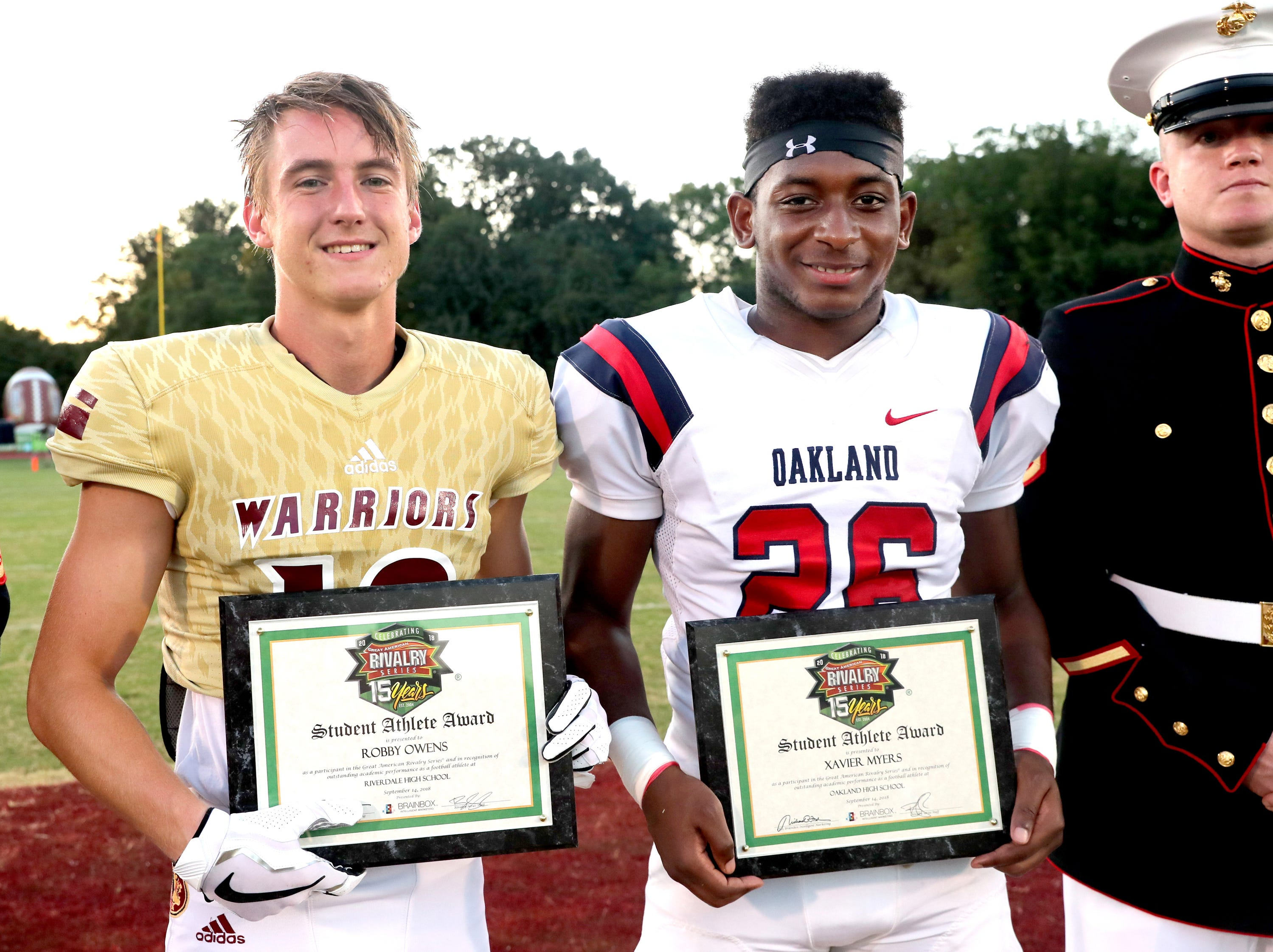 Riverdale's Robby Owens and Oakland's Xavier Myers both were presented with outstanding academic performance awards for their teams before the game between Oakland and Riverdale, during the Battle of the Boro, on Friday, Sept. 14, 2018, at Riverdale.