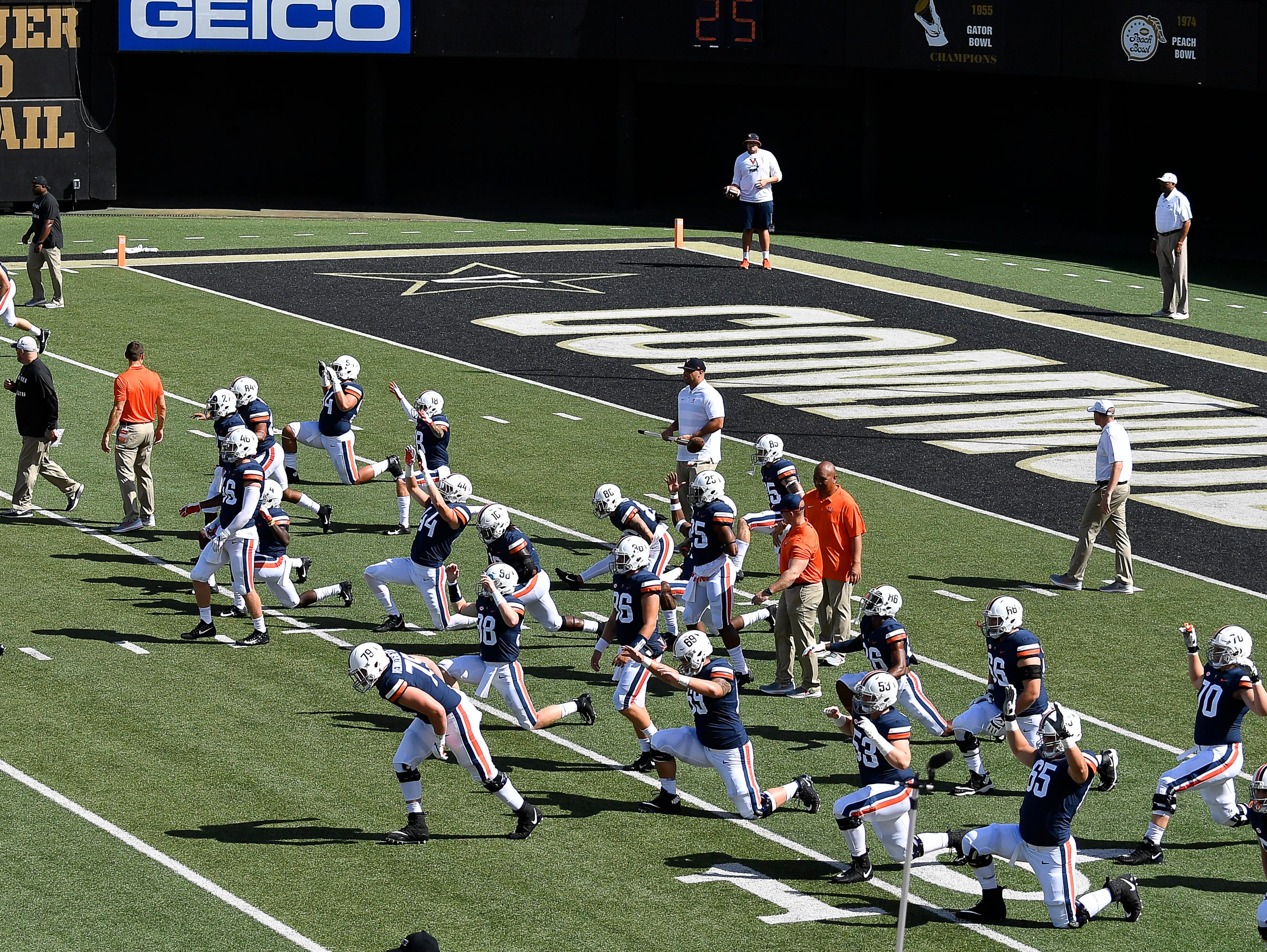 Virginia warms up before their game against Ohio at Vanderbilt Stadium Saturday, Sept. 15, 2018, in Nashville, Tenn.