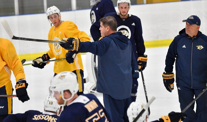 Predators head coach Peter Laviolette gives instructions to his players during training camp at Centennial Sportsplex Saturday, Sept. 15, 2018, in Nashville, Tenn.