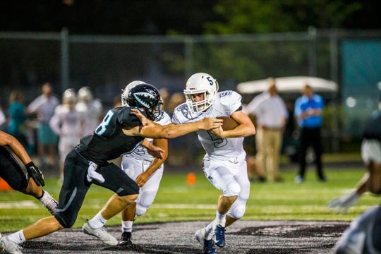 Naples senior Drew Wiltsie runs the ball during the game at Gulf Coast High School on Friday, Sept. 14, 2018.