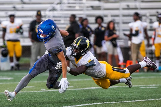 Barron Collier senior Gage Evans (9) gets tackled by Cortez McKenzie (6) during the game against St. Petersburg-Lakewood at Barron Collier High School in Naples on Friday, Sept. 14, 2018.