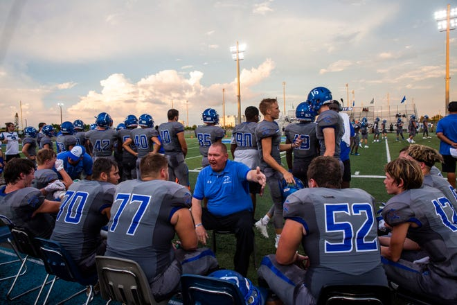 Barron Collier head coach Mark Jackson talks to his team during a break against St. Petersburg-Lakewood. The Cougars open their district schedule at Golden Gate on Friday night.