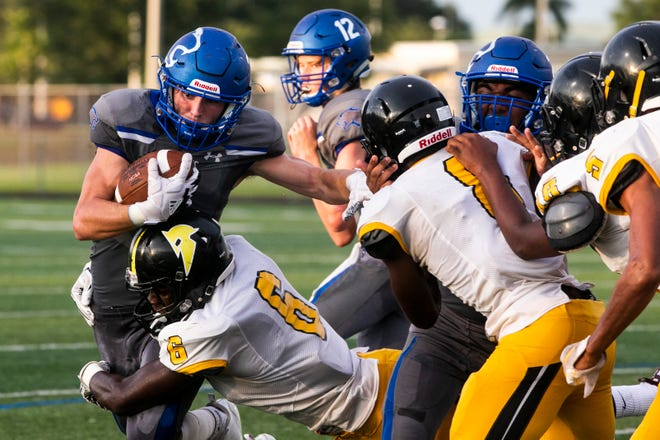Barron Collier junior Drew Powell (3) runs the ball against the St. Petersburg-Lakewood defense at Barron Collier on Friday, Sept. 14, 2018. Powell currently leads all running backs with 958 rushing yards. He's followed closely by Golden Gate's Jouvensly Bazile (925) and Naples' Chez Mellusi (900).