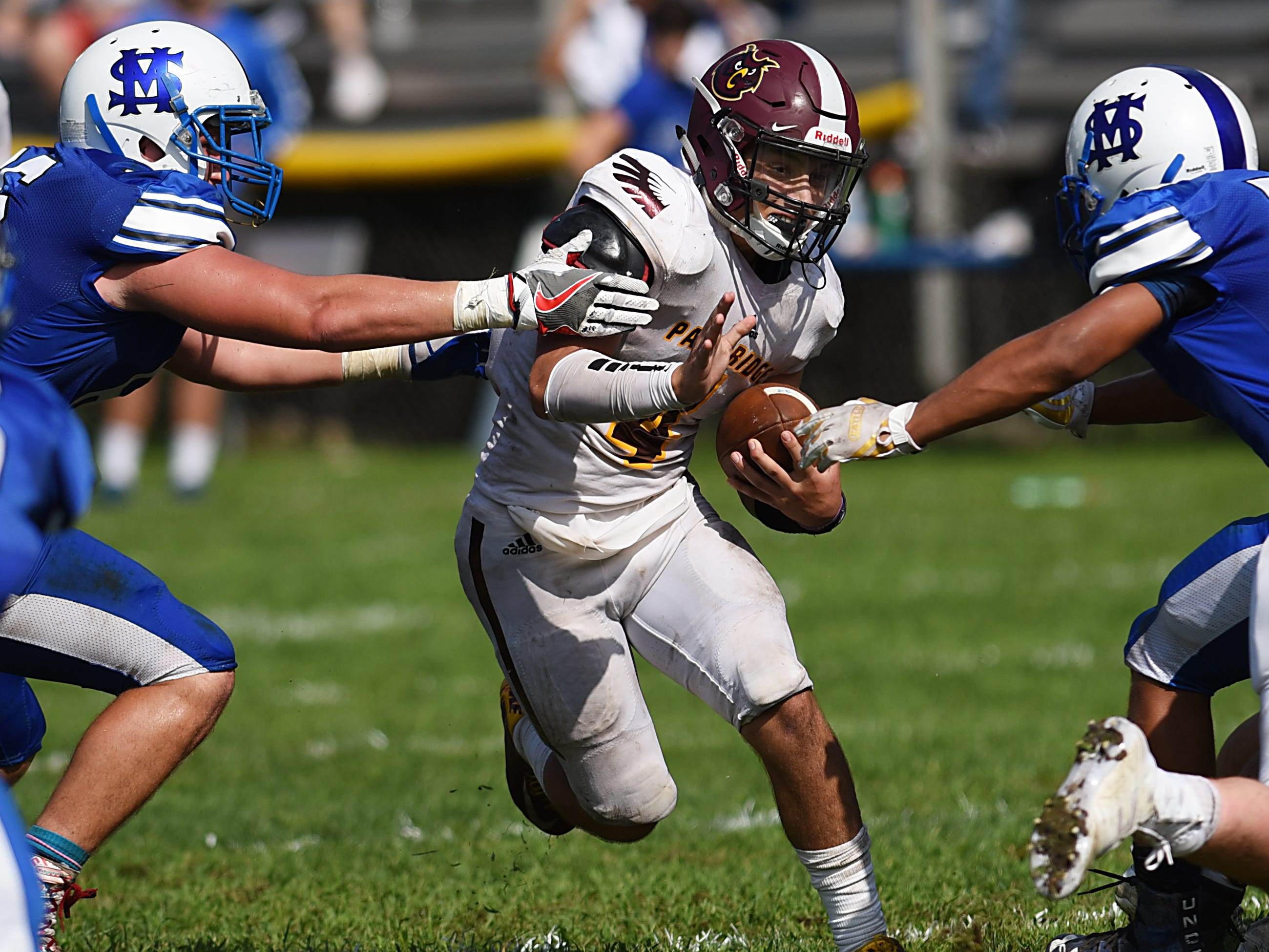 High school football game between Park Ridge and St. Mary at Tamblyn Field in Rutherford on Saturday September 15, 2018. PR#4 Vincent Pinto runs with the ball.