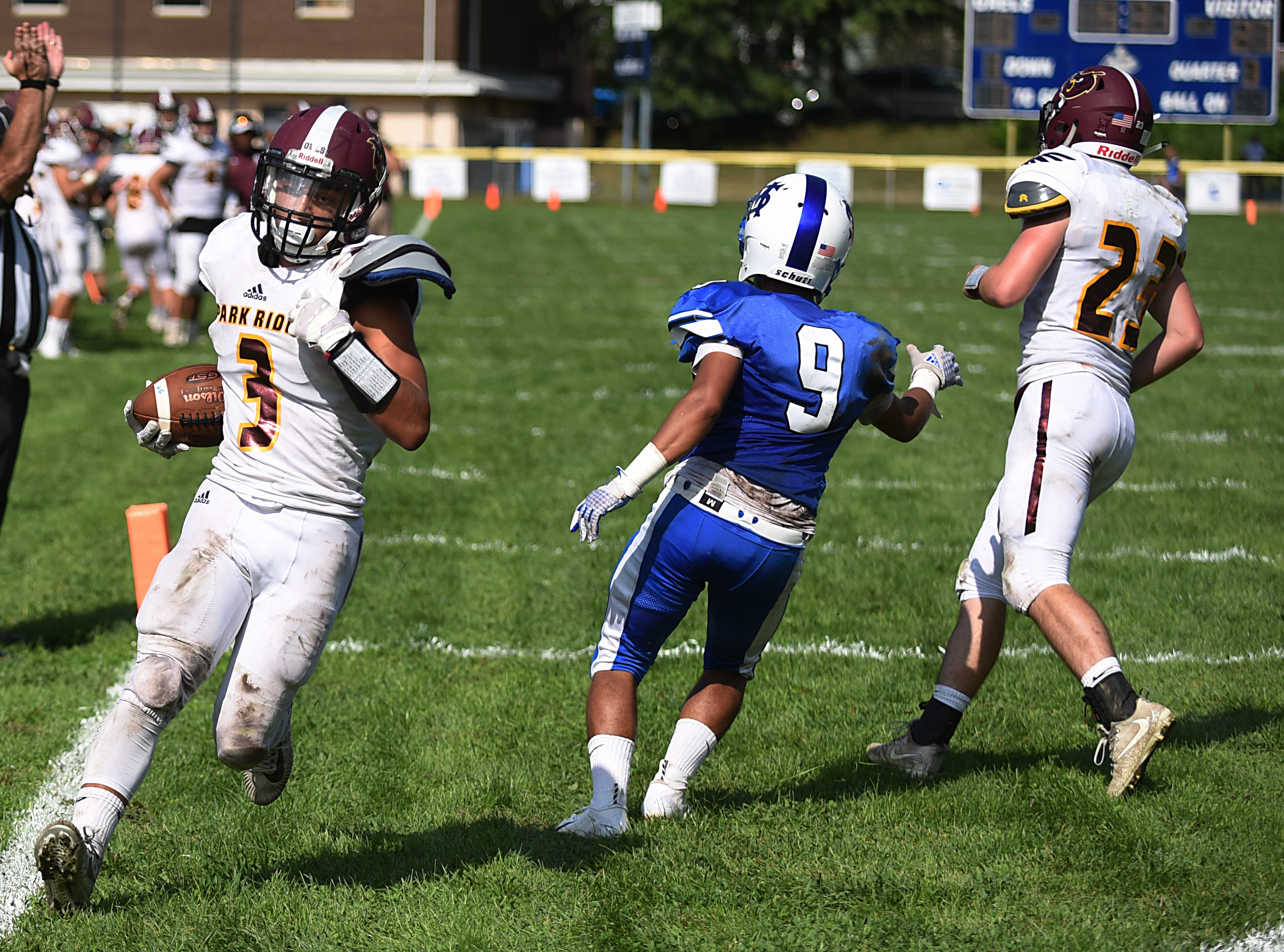 High school football game between Park Ridge and St. Mary at Tamblyn Field in Rutherford on Saturday September 15, 2018. (From left) PR#3 Justin Wagner, SM#9 Ethan Rivera and PR#23 Thomas Ryan.