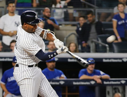 Sep 15, 2018; Bronx, NY, USA; New York Yankees third baseman Miguel Andujar (41) hits a grand slam home run against the Toronto Blue Jays during the seventh inning at Yankee Stadium.