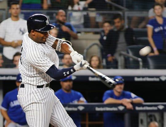 Sep 15, 2018; Bronx, NY, USA; New York Yankees third baseman Miguel Andujar (41) hits a grand slam home run against the Toronto Blue Jays during the seventh inning at Yankee Stadium.