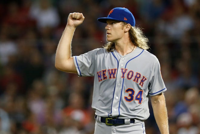 New York Mets  Noah Syndergaard (34) reacts at the final out of the fifth inning at Fenway Park.