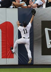Sep 15, 2018; Bronx, NY, USA; New York Yankees left fielder Brett Gardner (11) attempts to catch a double by Toronto Blue Jays first baseman Justin Smoak (14) during the fourth inning at Yankee Stadium.