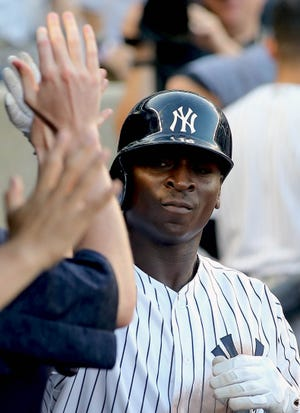 Sep 15, 2018; Bronx, NY, USA; New York Yankees shortstop Didi Gregorius (18) is congratulated after hitting a solo home run against the Toronto Blue Jays during the sixth inning at Yankee Stadium.
