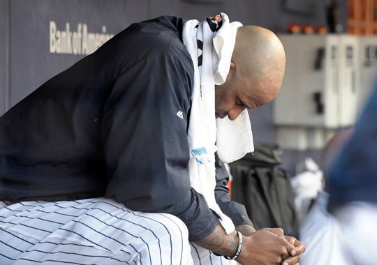 New York Yankees pitcher CC Sabathia sits on the bench after being taken out during the third inning of a baseball game against the Toronto Blue Jays Saturday, Sept.15, 2018, at Yankee Stadium in New York.