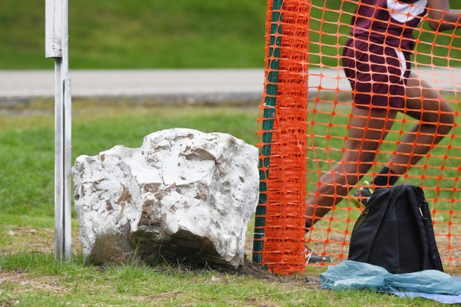 Garret Mountain Back To the Mountain meet on Saturday, September 15, 2018. A runner passes a stone near where the large Oak tree used to stand 200 meters from the finish.