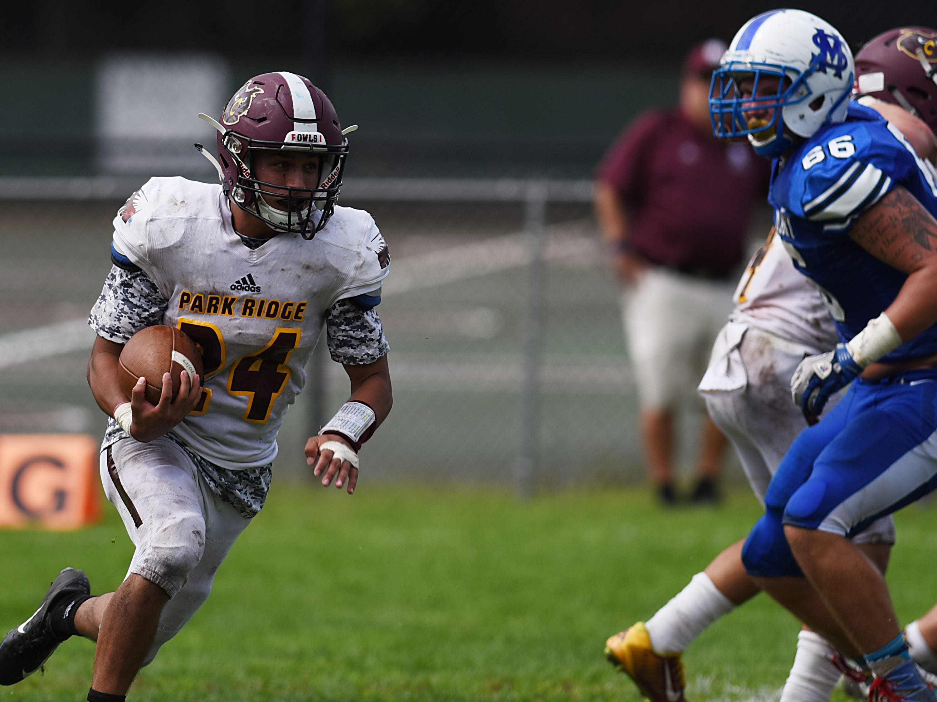 High school football game between Park Ridge and St. Mary at Tamblyn Field in Rutherford on Saturday September 15, 2018. (From left) PR#24 Marcus Raman and SM#66 Christopher Buchta.