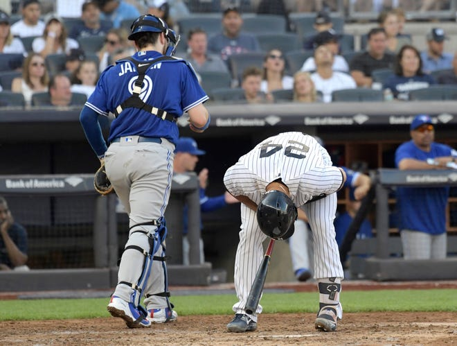 New York Yankees' Gary Sanchez (24) reacts after striking out to end the third inning of a baseball game as Toronto Blue Jays catcher Danny Jansen (9) heads to the dugout Saturday, Sept.15, 2018, at Yankee Stadium in New York.
