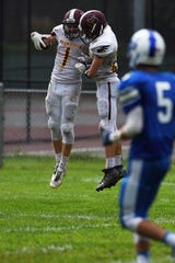High school football game between Park Ridge and St. Mary at Tamblyn Field in Rutherford on Saturday September 15, 2018. PR#1 Brendan Hughes and PR#25 Nicholas Shappell celebrate.