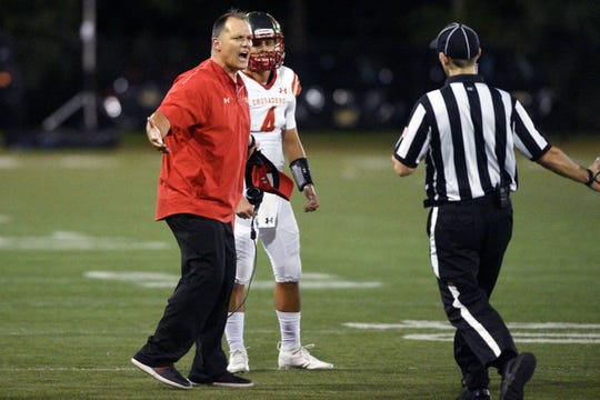 Bergen Catholic plays at St. Peter's Prep at Cochrane Stadium at Caven Point in Jersey City on Friday, September 14, 2018. BC coach Vito Campanile and #4 Andrew Boel in the second quarter.