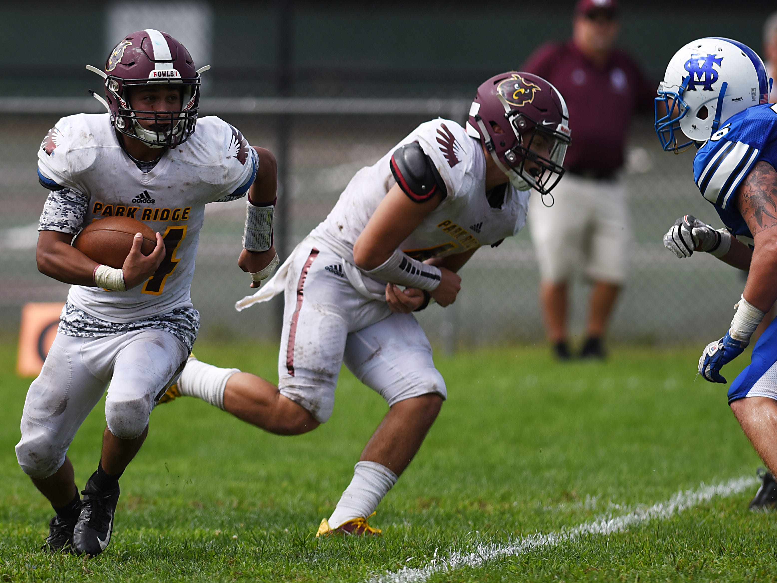 High school football game between Park Ridge and St. Mary at Tamblyn Field in Rutherford on Saturday September 15, 2018. (From left) PR#24 Raman Marcus, PR#4 Vincent Pinto and SM#66 Christopher Buchta.