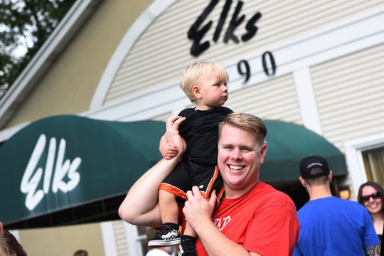 Austin Maier, 13 months, sits atop Jason Maier's shoulders at the New Milford Elks lodge during the Darren Drake Memorial Walk in New Milford on Saturday September 15, 2018.