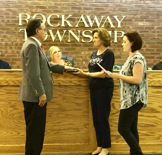 Paul Minenna, who served 17 years on the Township Council, is sworn in as Rockaway Township's interim mayor until the November elections.