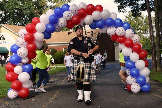 Donald L. Kozlowski, pipe major with the Union County Police & Fire Pipes and Drums, plays the bagpipes at the start of the Darren Drake Memorial Walk in New Milford on Saturday September 15, 2018.