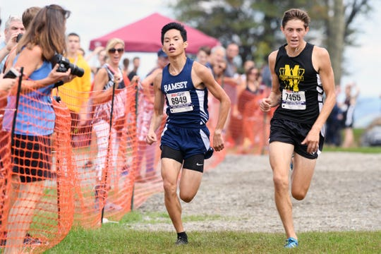 Joey Cummings, of West Milford, (right) on his way to holding off David Perry of Ramsey, near the finish of the Boys varsity B race at the Back to the Mountain meet at Garret Mountain Saturday, Sept. 15, 2018.