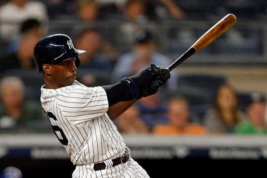 New York Yankees right fielder Andrew McCutchen #26 hits a double against the Toronto Blue Jays during the first inning at Yankee Stadium.