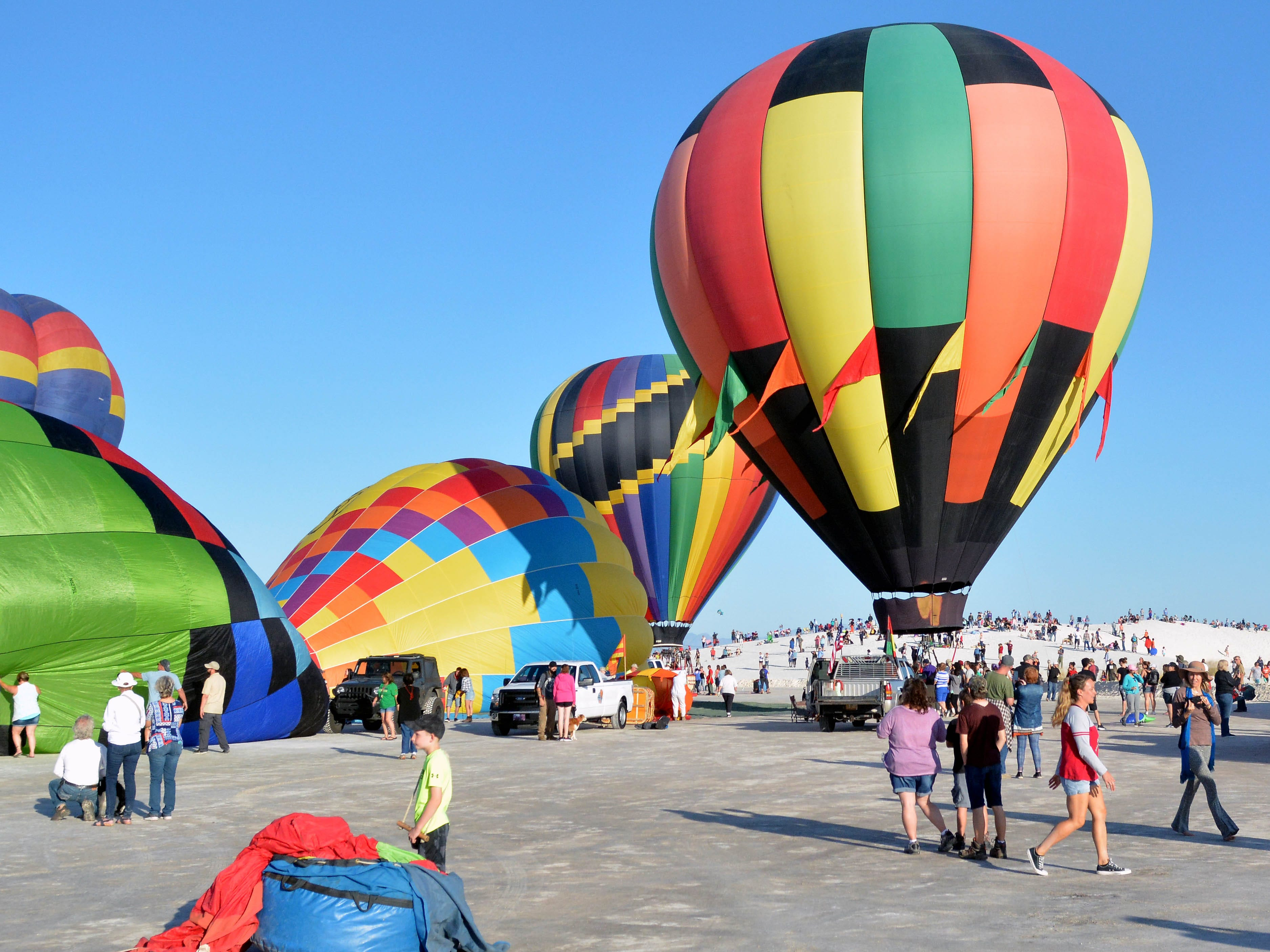 Balloons start to inflate as spectators line the dunes Saturday, Sept. 15, 2018 at the White Sands Balloon Invitational.