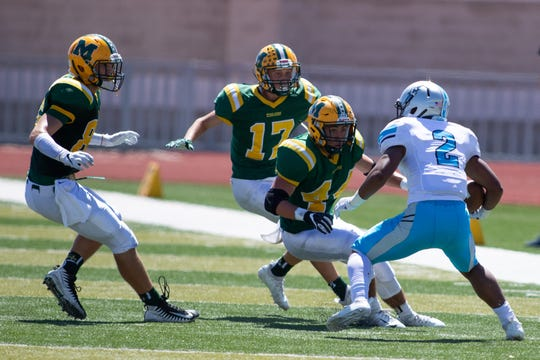 Mayfield's AJ Parra, hones in on Cleveland's Lewis Dorian Saturday at the Field of Dreams.