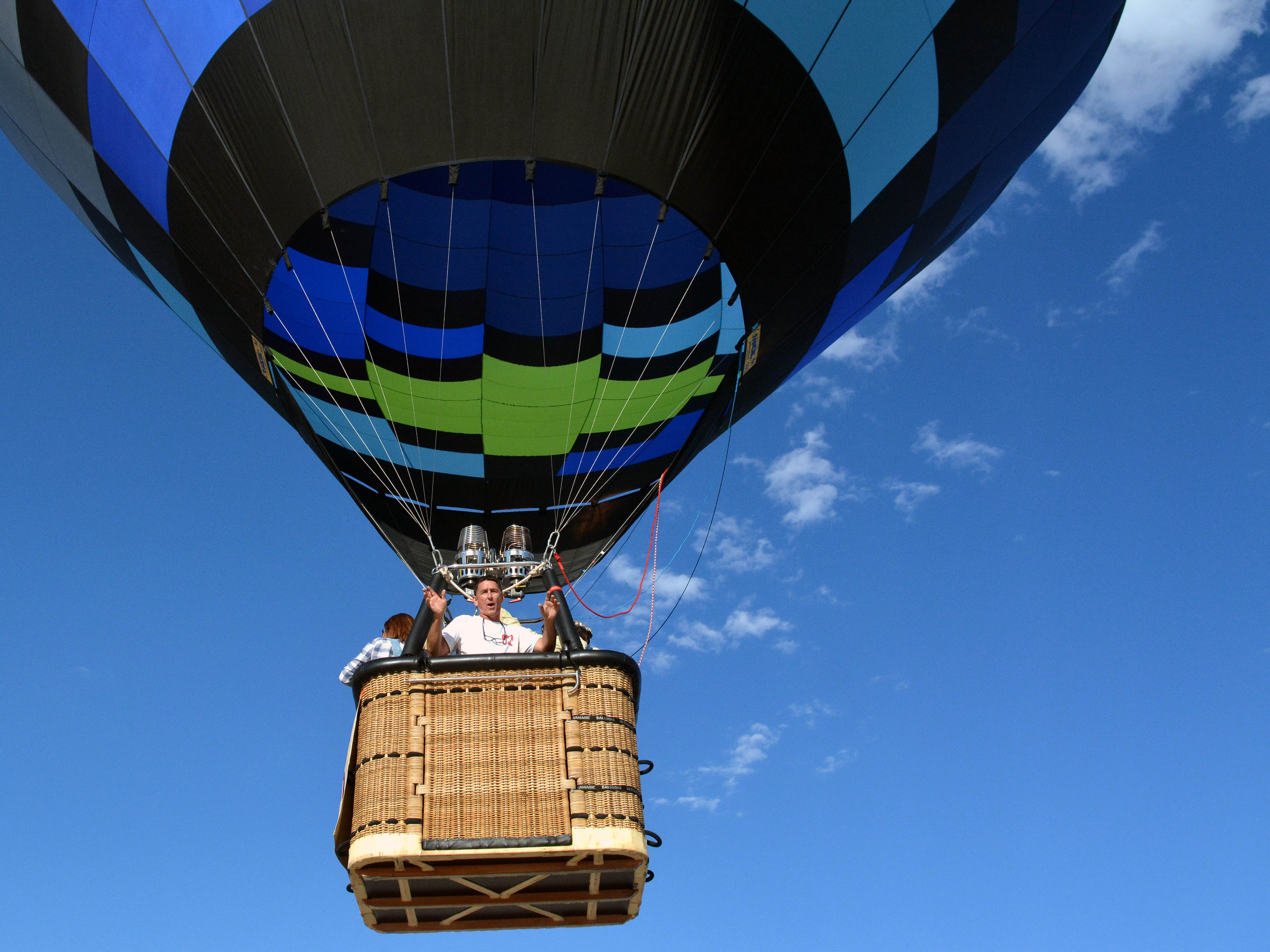 The crew of a hot air balloon wave to the crowd below Saturday, Sept. 15, 2018 at the White Sands Balloon Invitational.